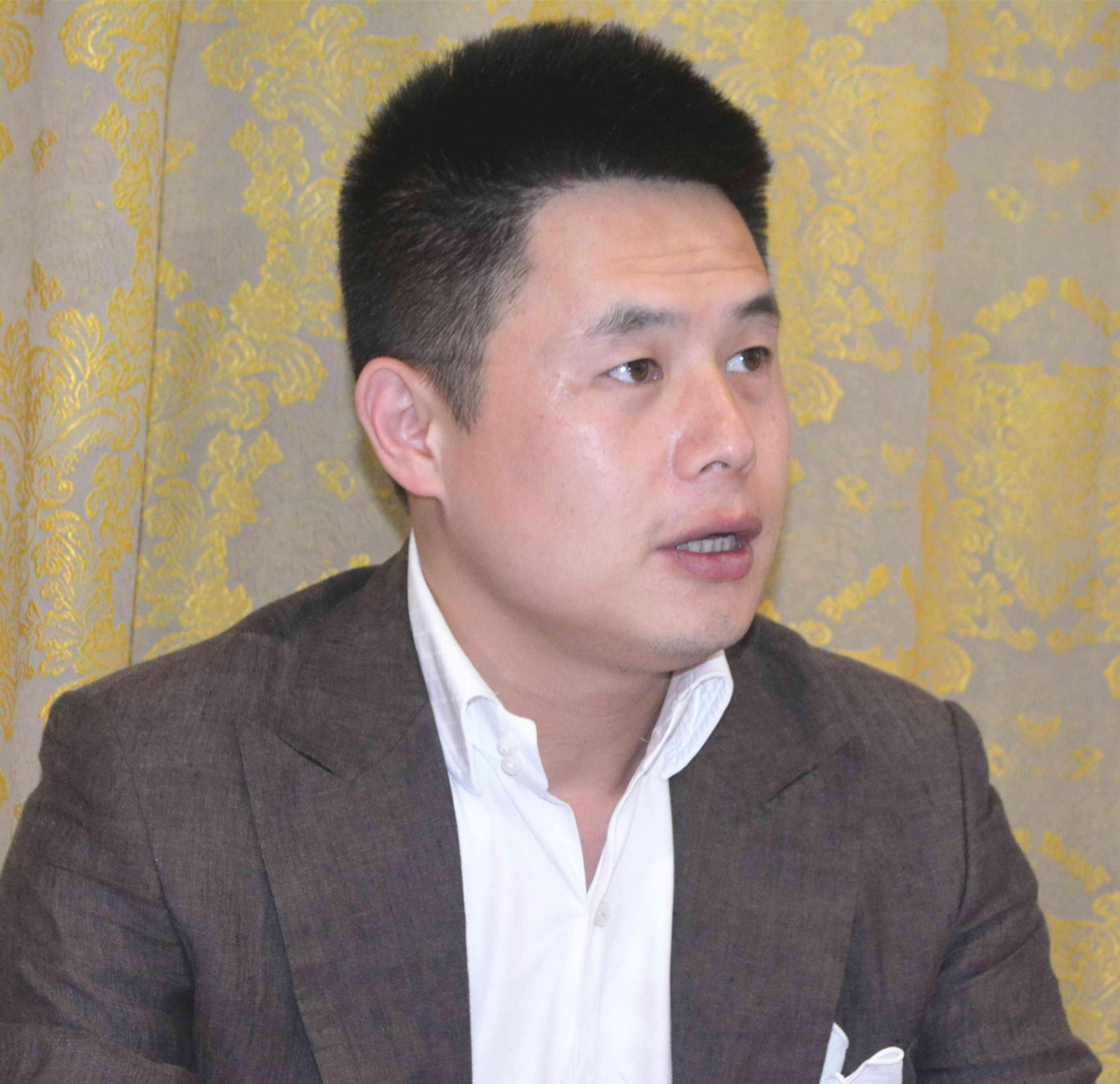 章起华,上海滩金融集团董事长.jpg